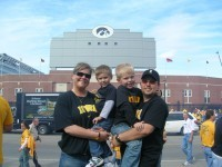 Amy Osenbaugh Brinkmeyer and her husband, Corey, with sons Mitchell and Graham at the 2008 Iowa-Ohio State game at Kinnick Stadium.